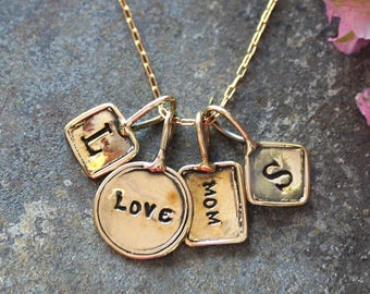 Gold Necklace with stamped initial charms.  Trinket Initial Necklace with stamped charms in Gold.  Gold Initial Necklace with Stamped Charms