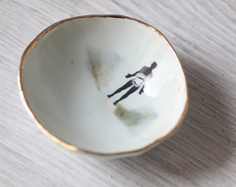small Hand built  White shallow Bowl with  Gold Trim, and Tiny Human