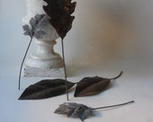 hold for paula - five vintage rusty tin leaves (please do not purchase unless you are paula)