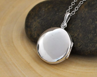 round sterling silver locket necklace. simple everyday wear. photo locket.