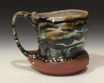 Earthy toned mug with gold accents