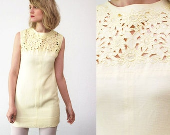 SALE...Pastel yellow 60s mini dress. cut out dress. 60s summer dress with metal zipper - xs