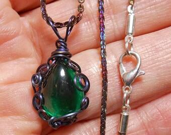Nanoemerald cabochon pendant, synthetic single sided pear, hand wrapped, heat colored titanium  filigree setting
