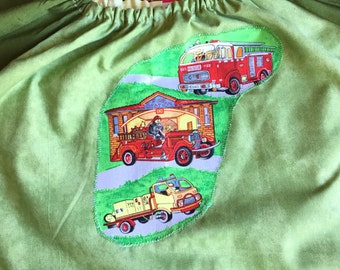Age 9 to 12 kids craft apron, kids art smock, long sleeve waterproof front. Fire trucks.