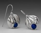 4 pairs of earrings sent by FedEx