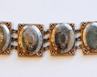 1950s Hattie Carnegie gold and silver tone lockets bracelet / 50s vintage collectible rare designer triple locket wide link bracelet