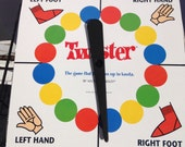 One Vintage Twister game spin board with red socks, right hand, and left hand.