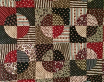 Hand quilted patchwork wall hanging, small lap quilt, circle quilt, red black tan