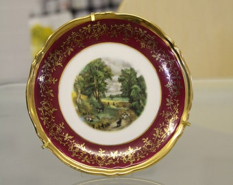 Burgundy and gold gilt patterned landscape scene plate by Limoges