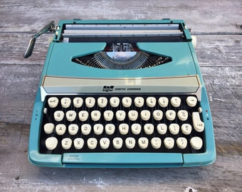 1960s Smith-Corona Corsair Deluxe typewriter in aqua teal with cover carrying case, vintage portable typewriter, manual typewriter