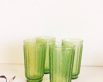 set of four vintage green glassware