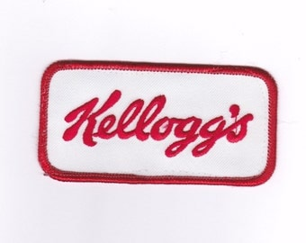 Kellogg's Applique Patch ~ Red Satin Stitch Embroidered Border & Letters  White Background ~ 4 Inches Long By 2 Inches Wide ~ Ready To Use