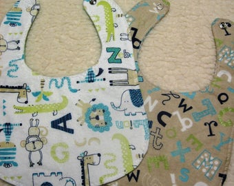 Matching set of 2 bibs, jungle animal and alaphbet flannel bibs with metal snap closures at neckline