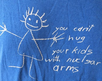 """Anti-war peace t-shirt """"You Can't Hug Your Kids with Nuclear Arms"""" size large or XL 1980's"""