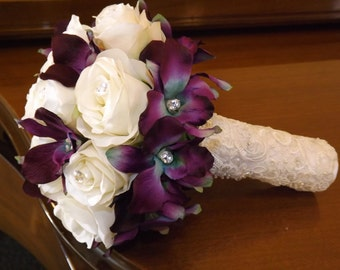 Fabulous bouquet created with white roses, blue galaxy orchids and crystals and lace, bouquet and boutonniere package