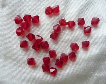 Bead, Czech pressed glass, 6mm Red Bicone. Pack of 29 beads.