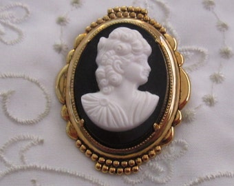 Vintage Gold Tone Brooch with Black and White Plastic Cameo