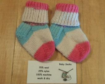 Tiny White/dark pink/pink/blue hand knit baby socks