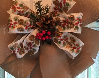 Large Winter door burlap bow w/ white ribbon w/ pine cone design and evergreen and pinecone center
