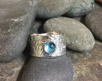 Warrior princess water ring reticulated sterling with swiss blue topaz