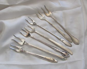 Lot of 7 Silver Plate 2 Prong Forks Crab Seafood Olive - Mixed Patterns (#8)