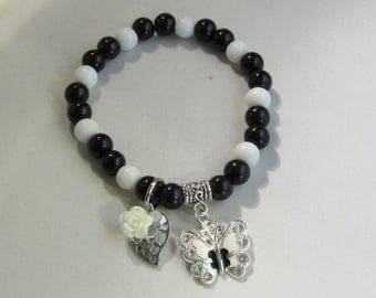Black and White With Butterfly and Leaf Charm Stretchy Bracelet