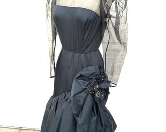 A vintage 1970s 1980s designer Rose Taft couture fashion bead fit and flare black taffeta formal gown size S
