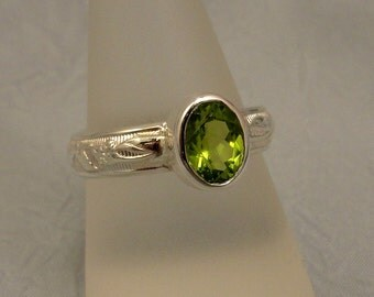Faceted Peridot and Sterling Ring
