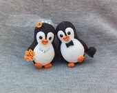 Happy Penguin bride and groom wedding cake toppers