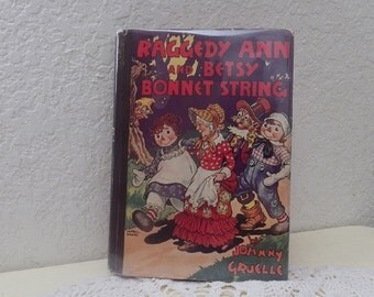 Raggedy Ann and Betsy Bonnet String, hardcover book with dust jacket.Johnny Gruelle, 1st Ed 1943.