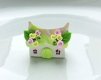 Miniature fairy cottage in pink, yellow and pale green handmade from polymer clay
