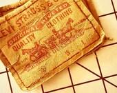 vintage levi jeans labels, worn, textured, crinkled, washed, nostalgic, rustic, americana
