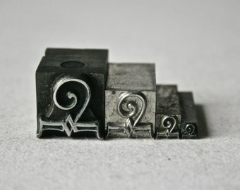 Four Vintage Letterpress Dingbat Swirls in Graduated Sizes for Printing and Stamping