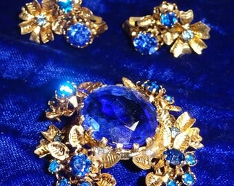 Antique Austria signed floral brooch and earrings Demi blue rhinestone flowers ornate filigree Signed Made in Austria Blue Open Back stone