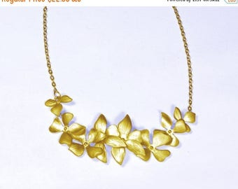 20% off. Flower necklace. Wild orchid flower  Necklace in gold with 8 flowers Bridal weddings bridal chain necklace