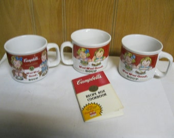 "Vintage Campbell Soup Kids Collectible Mugs With Famous Trademark saying ""M'm! M'm! Good!"" 3 Mug Set Plus Campbell's Recipe Box Cookbook"