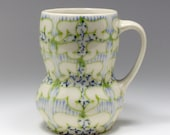 Handmade Wheel Thrown Ceramic Mug with Kiwi, Sky Blue and Navy Blue Pattern