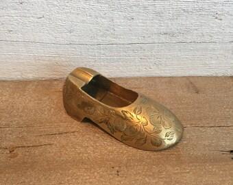 Small brass shoe ashtray