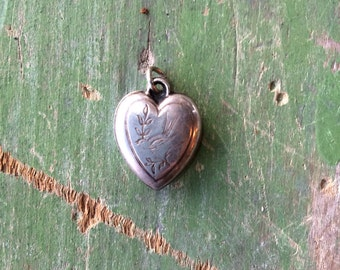 Vintage silver heart charm with etched bird