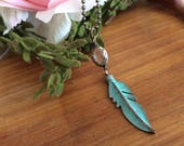 Turquoise bohemian feather with Bronze Wrapped Crystal Necklace