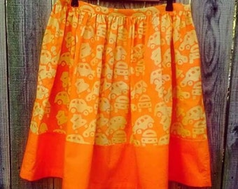 "XL. African batik  ""cars and trucks"" fabric women's skirt with zipper in fair trade fabric. Knee length. Bright orange."