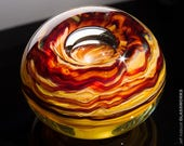Unique Hand Blown Glass Paperweight - Earthy Brown and Ruby Squiggles with Bubble