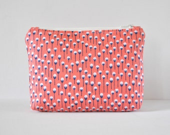 Woman's padded cosmetics beauty travel make up pouch tiny little dandelion flowers seed print in coral pink, white and navy blue in large.