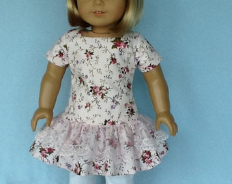 18 inch doll ruffled dress, leggings, and hair clip. Fits American Girl Dolls.  Pink floral print.