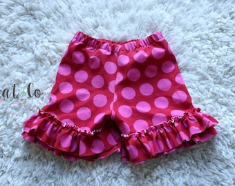 Double ruffle knit shorts in light purple with white dots.  Size 2t.
