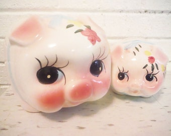 Two piggy banks pig shaped mid century vintage pink yellow ceramic