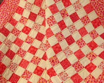 """HOLIDAY SALE A 39"""" X 43"""" Postage Stamp Quilt In Hues Of Red, Pink, Yellow and White"""