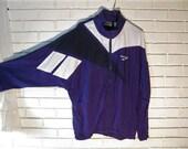 Vtg Reebok PURPLE nylon jacket with hood size M