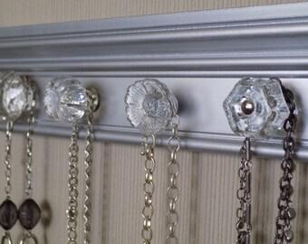 "Silver Jewelry Organizer This necklace organizer has 4 Glass or clear acrylic  knobs 12"" of Hanging  jewelery oranization."