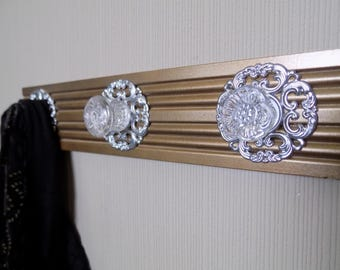 Bronze gold coat rack with 3  large glass knobs and decorative backplates. ideal for robe purse coat or decor only